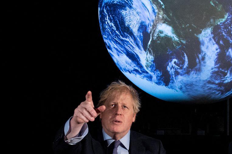 Premier Johnson, vorig jaar, aan de vooravond van de Klimaatconferentie van Glasgow.  Beeld Hollandse Hoogte / AFP