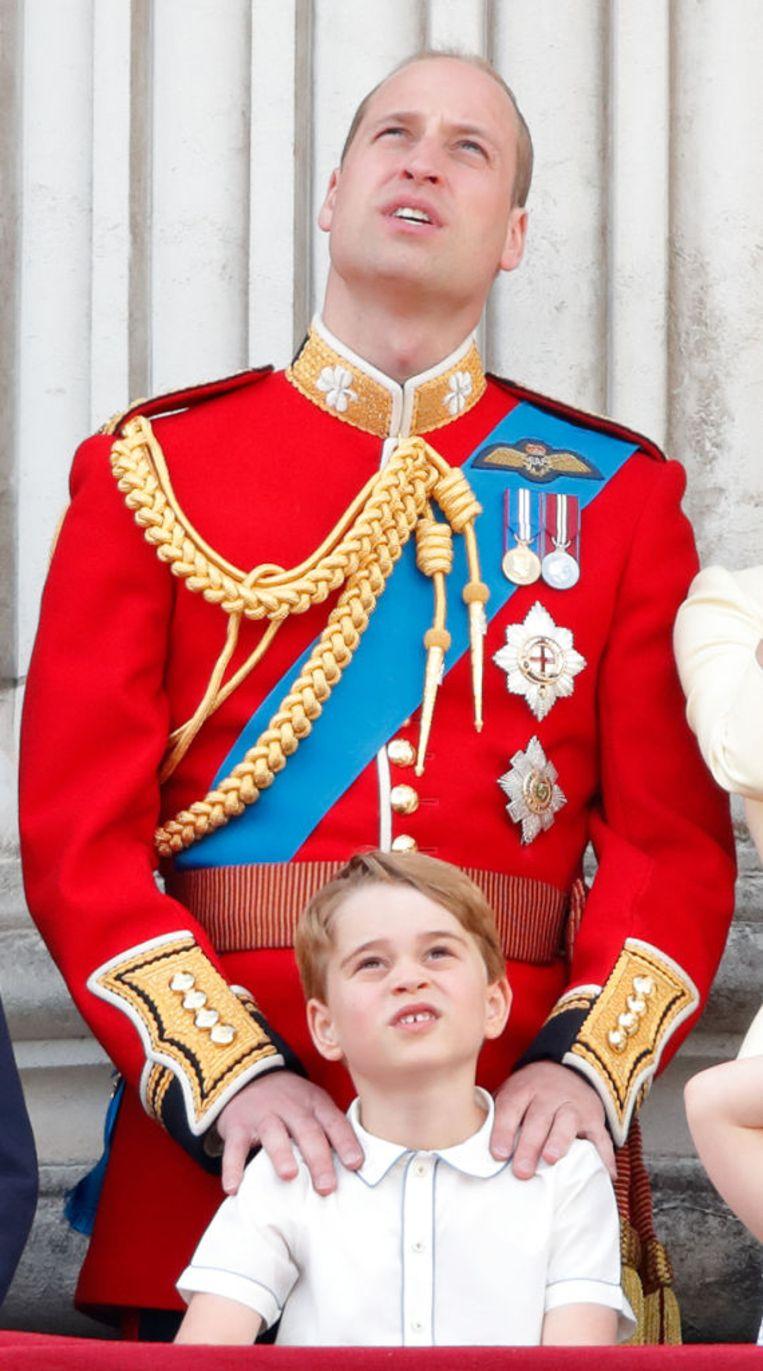 William met zijn oudste zoon George. Beeld Getty Images