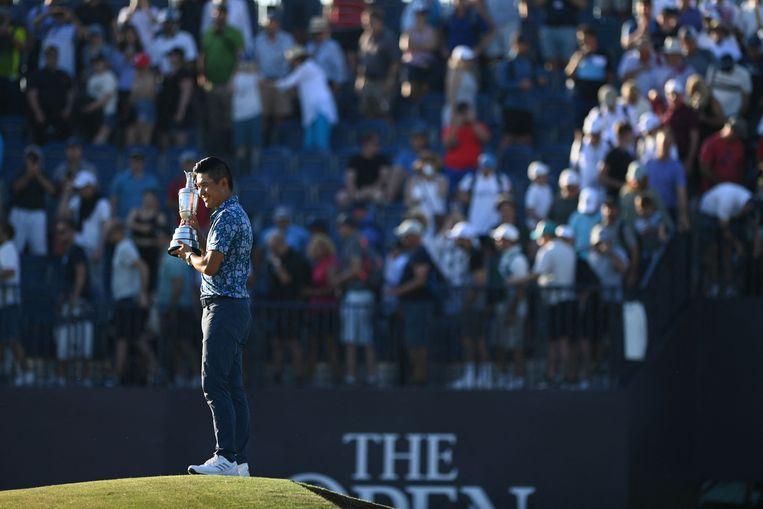 Collin Morikawa wordt gehuldigd na het winnen van The Open. Beeld AFP