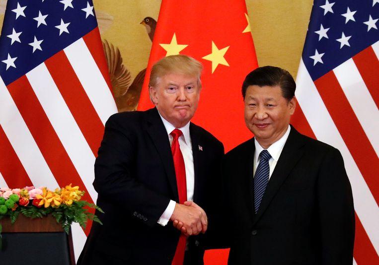Amerikaans president Donald Trump en zijn Chinese collega Xi Jinping tijdens een persconferentie in Peking vorig jaar november. Beeld REUTERS