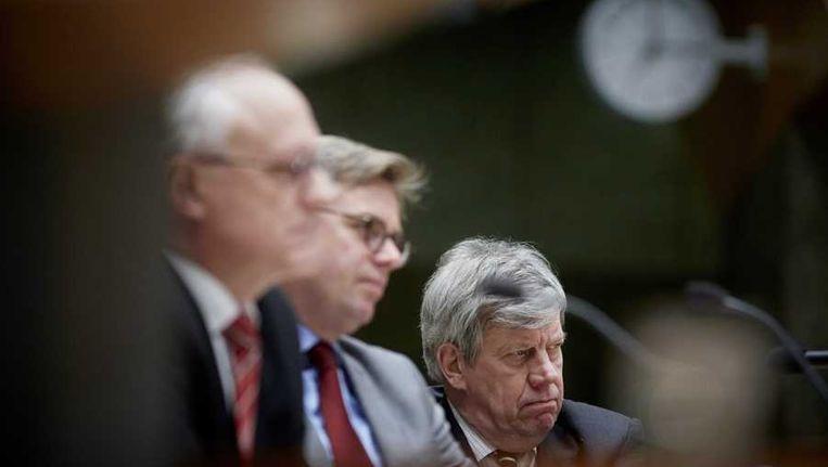 SP-Kamerlid Jan de Wit, D66-Kamerlid Gerard Schouw en minister van Justitie Ivo Opstelten tijdens het debat over godslastering in de Tweede Kamer. Beeld anp