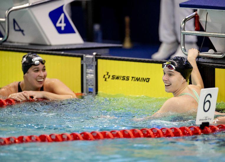 Valerie van Roon (rechts) en Ranomi Kromowidjojo na de 50 meter vrije slag in Rotterdam. Beeld ANP