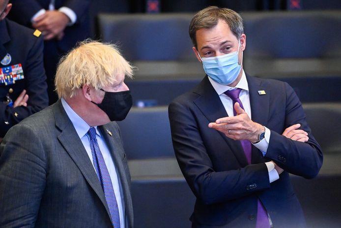 Le Premier ministre Alexander De Croo et son homologue britannique Boris Johnson lors d'un sommet de l'Otan à Bruxelles, le 14 juin 2021.