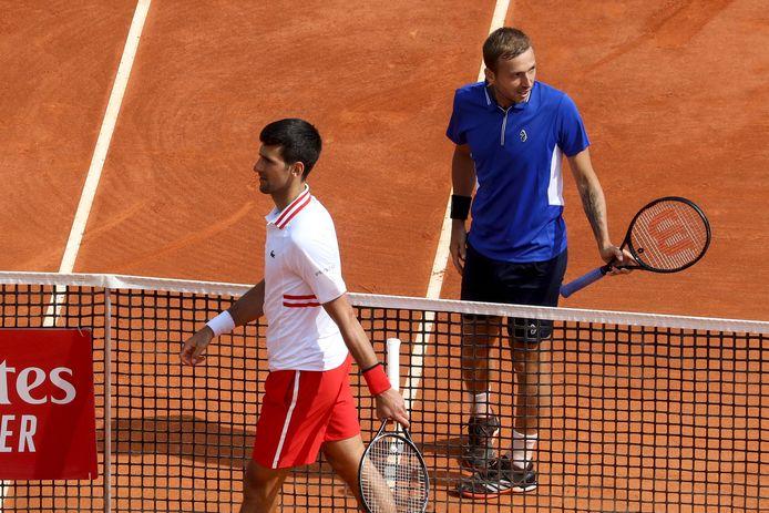 Djokovic (l) en Evans.