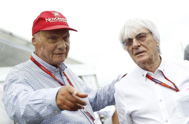 Lauda met Formule 1-baas Bernie Ecclestone op 2 juli 2016. Beeld afp