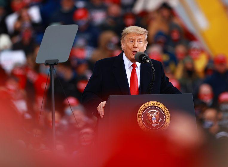 De Amerikaanse president Trump spreekt tijdens een rally in Muskegon, Michigan. Beeld AFP