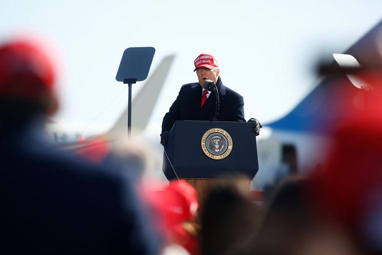 John Grisham: 'Onze president is niets meer dan een aangespoelde oude hedonist die zijn hele leven achter geld, roem en vrouwen heeft aangezeten.' Beeld Getty Images