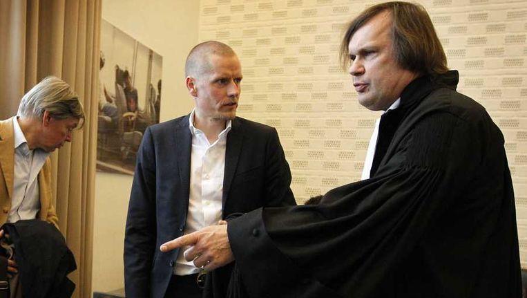 Michael Rasmussen en advocaat André Brantjes. Beeld anp