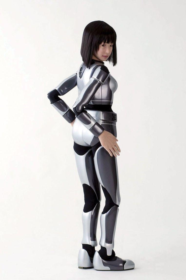 Ze praat, lacht en wandelt, weegt 43 kilo en is 1,58m lang. De Japanse humanoïde robot, ontworpen door Kazuhito Yokoi, luistert naar de naam HRP-4C, alias Miim. Afhankelijk van de gebruikte software kan ze ook dansen of zingen; verder functioneert Miim prima als mannequin die op de catwalk bruidskleding showt. Foto © EPA Beeld