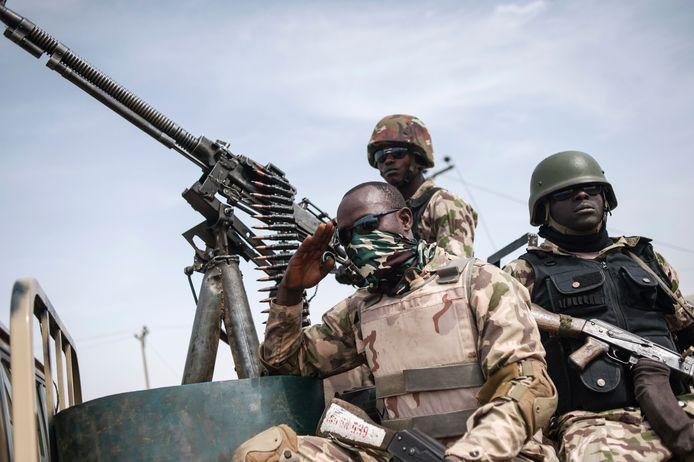 Soldaten van de 7e divisie van het Nigeriaanse leger tijdens het heroveren van stukken land op Boko Haram in de omgeving van Damboa in het noordoosten van Nigeria.