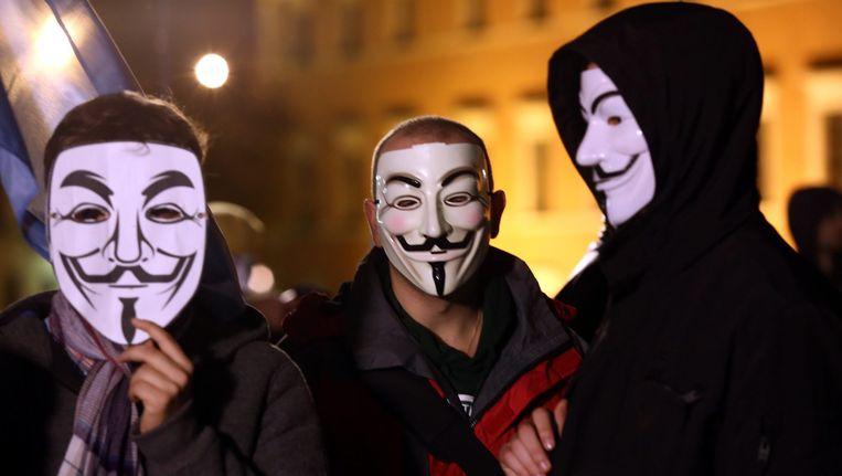 Sympathisanten van de hackersgroep Anonymous. Beeld epa