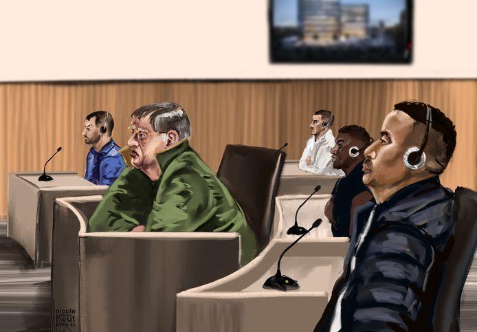 Verdachte manegehouder Jan B., in groene jas, en enkele medeverdachten uit Colombia.