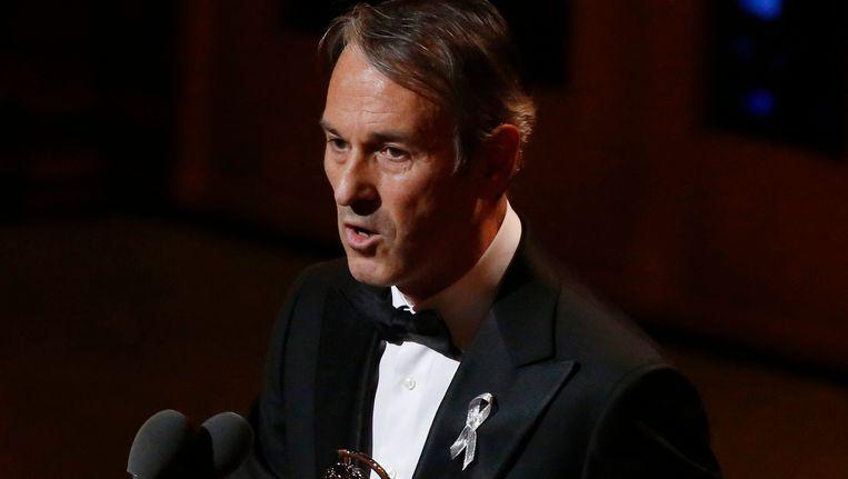 Ivo van Hove neemt zijn Tony Award in ontvangst. Beeld REUTERS