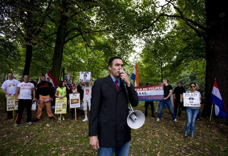 NVU-leider Constant Kusters tijdens een demonstratie in Den Haag in 2014.  Beeld anp