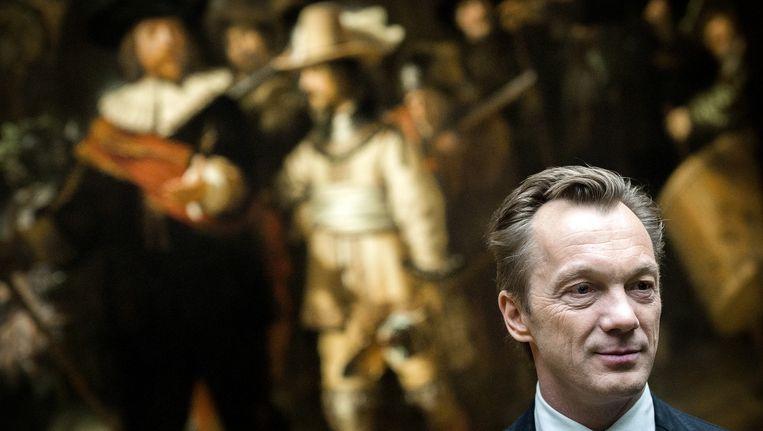 Wim Pijbes met op de achtergrond de Nachtwacht van Rembrandt. Beeld anp