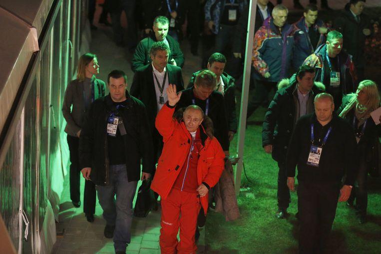 Vladimir Poetin brengt een bezoek aan het Holland Heineken House tijdens de Olympische Spelen in Sotsji Beeld anp