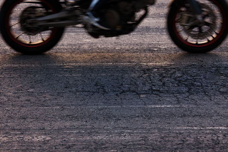 Rapidly traveling along the asphalt road bike Beeld Getty Images/iStockphoto