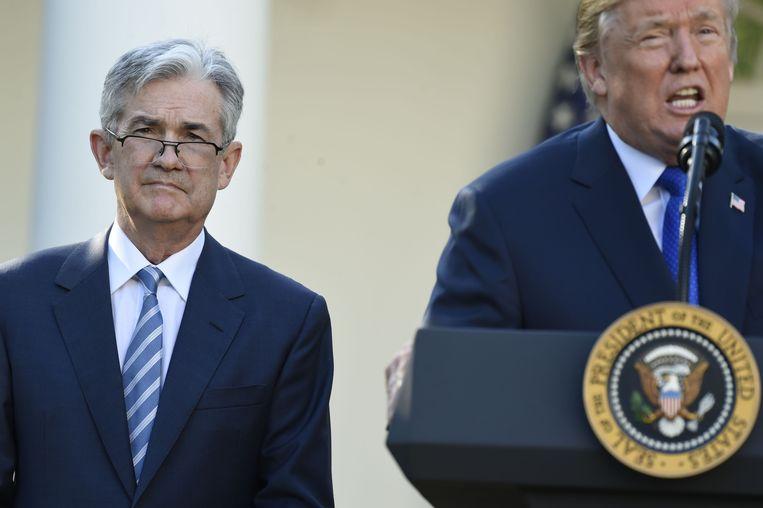 Jerome Powell naast president Trump. Beeld AFP