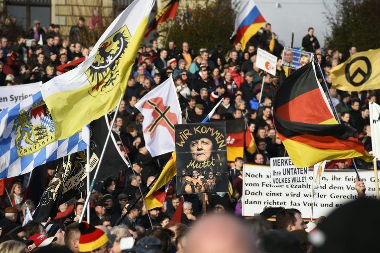 Betoging van anti-islambeweging Pegida eerder deze maand in Dresden. In die stad in Saksen werd Pegida opgericht, en dat imago van xenofobie zou de Duitse deelstaat op economische schade komen te staan. Beeld AFP