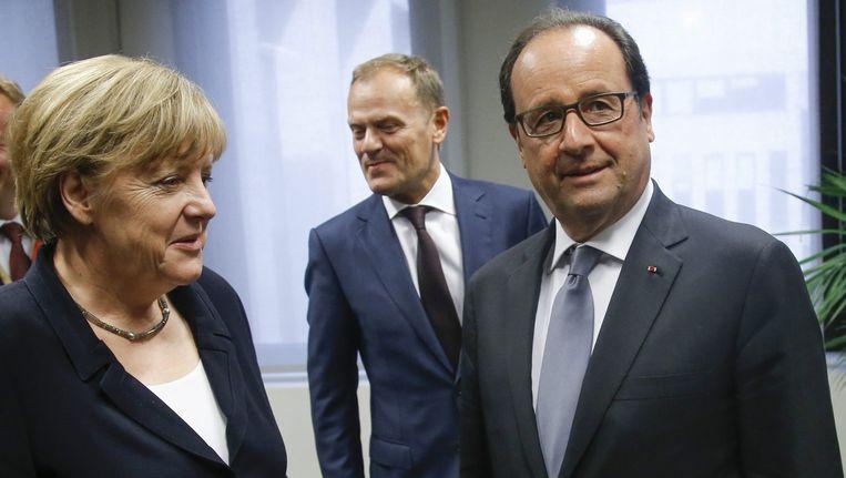 De Franse president Hollande (R), EU-president Donald Tusk (M) en Bondskanselier Angela Merkel. Beeld anp