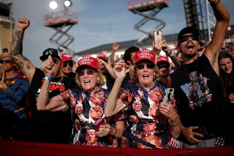 Trump-supporters bij een rally in Florida vorig jaar. Beeld REUTERS