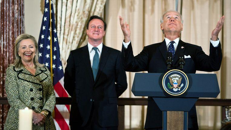 Joe Biden (rechts), Hillary Clinton en David Cameron. Beeld getty