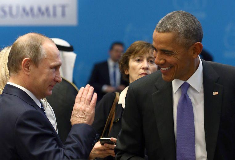 Obama (rechts) en de Russische president Poetin. Beeld reuters
