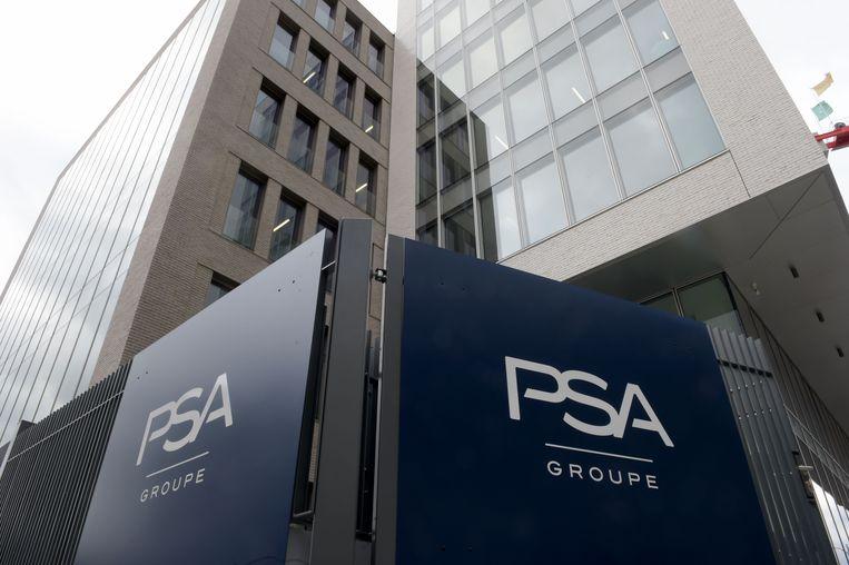 Het hoofdkwartier van PSA in Rueil-Malmaison, nabij Parijs. Beeld AFP