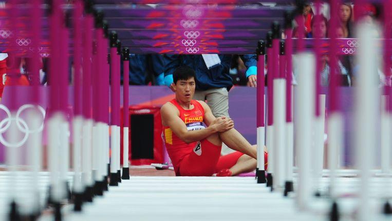 Liu Xiang tijdens de Spelen in Londen. Beeld GETTY