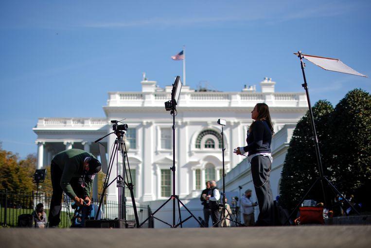 Journalisten bij het Witte Huis. Beeld REUTERS