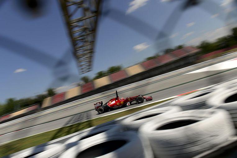 F!-coureur Kimi Räikkönen (Ferrari) in actie op het circuit van Catalunya. Beeld afp