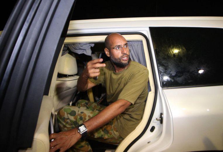 Saif Khadafi op een foto uit 2011, toen hij de dictatuur van zijn vader in Libië verdedigde. Beeld AFP