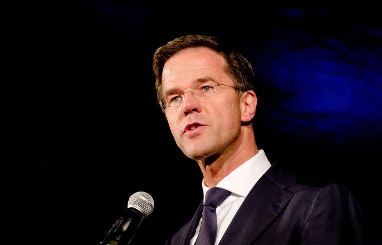 Premier Mark Rutte spreekt op de Dam tijdens een demonstratie naar aanleiding van de aanslag in Parijs. Beeld anp
