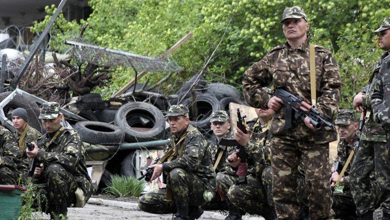 Oekraïense troepen in de zuidelijke havenstad Marioepol. Beeld AP
