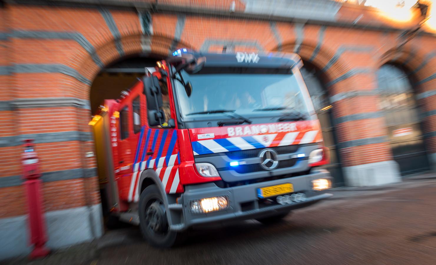 Een brandweerauto rukt uit na een melding. (Foto ter illustratie)