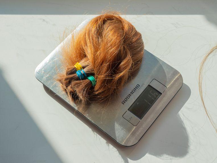 Het gewicht van het haar bepaalt de prijs. Beeld Tom Skipp