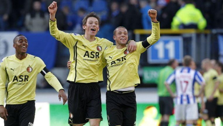 Stefan de Vrij en Luc Castaignos (r), hier gezamenlijk juichend na de winst op SC Heerenveen in de voorbije voetbaljaargang, maakten nog nooit hun opwachting bij Jong Oranje. ©PRO SHOTS Beeld