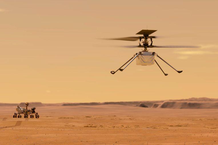 Deze illustratie van NASA maakt duidelijk wat de plannen zijn van Marshelikopter Ingenuity: de eerste gecontroleerde vlucht op een andere planeet. Op de achtergrond kijkt rover Perseverance toe. Beeld AP