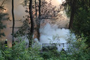 Houtopslag in bos in Breda in lichterlaaie