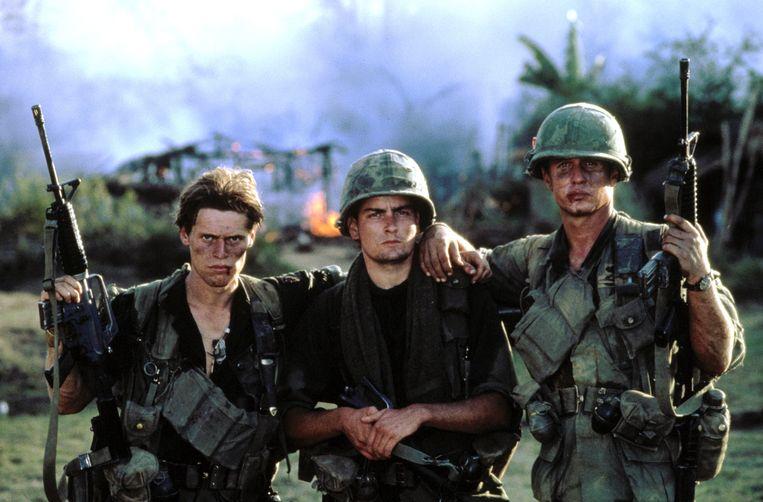 Van links naar rechts: Willem Dafoe, Charlie Sheen en Tom Berenger in 'Platoon'. Beeld Orion Pictures via Everett Colle