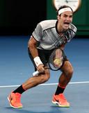 Roger Federer schreeuwt het uit na het winnende punt