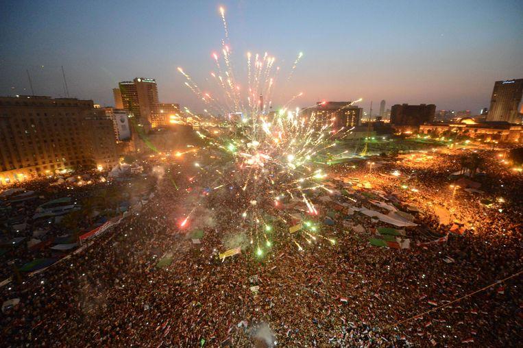 Vuurwerk op het Tahrirplein in Caïro na de verkiezingen in juni 2012, waar Mohamed Morsi als president werd verkozen. Beeld AFP