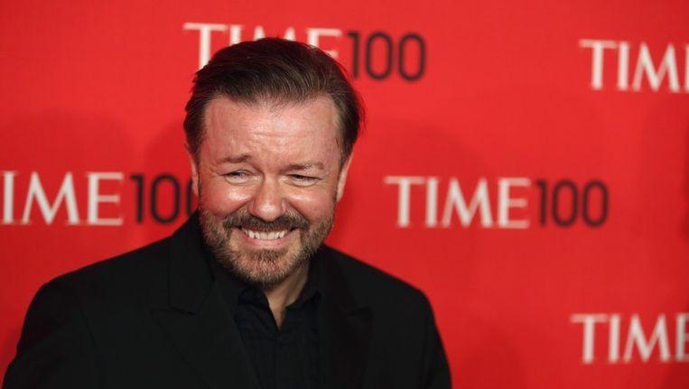 Ricky Gervais kan zijn lachen niet inhouden op het Time 100-gala voor de honderd invloedrijkste mensen ter wereld, waar Gervais Justin Timberlake tegen het lijf liep. Beeld reuters