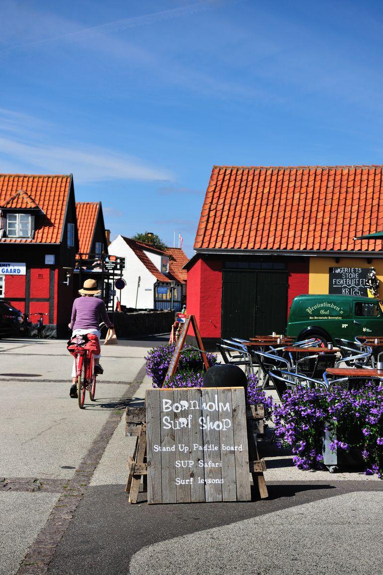 Een ontspannen, zuiderse lifestyle: van fietsen tot surfen in de Baltische Zee.  Beeld DAVID DE VLEESCHAUWER