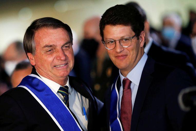 De Braziliaanse president Jair Bolsonaro (links) met minister van Milieu Ricardo Salles op archiefbeeld. Beeld REUTERS