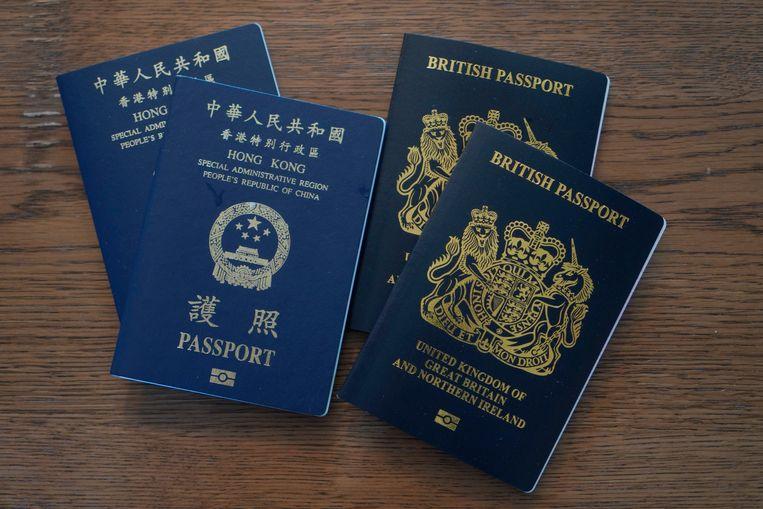Hongkongse en Britse paspoorten. Beeld AP
