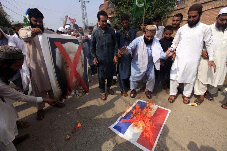 In Peshawar, Pakistan wordt op 17 augustus een afdruk van de Nederlandse vlag verbrand. Beeld null