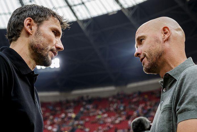 Trainers Mark van Bommel (PSV) en Erik ten Hag (Ajax).