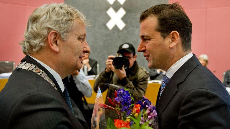 Eberhard van der Laan en Lodewijk Asscher bij Asschers afscheid van de Amsterdamse politiek in 2012 Beeld ANP
