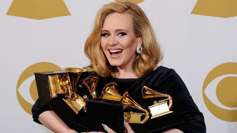 Adele met haar Grammy's. Beeld getty
